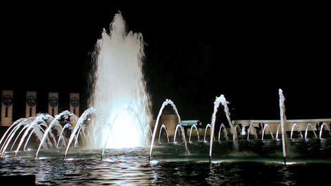 A static shot of an amazing water fountain at night Footage
