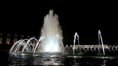 A static shot of a beautiful water fountain at night Footage