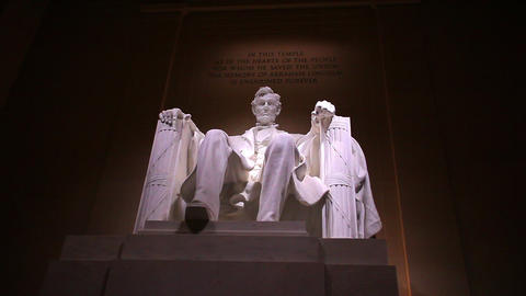 Static shot of Abraham Lincoln statue at the Lincoln Memorial in Washington DC a Footage