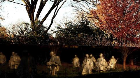 Tilt shot of the Korean War Veterans Memorial wall in Washington DC Live Action