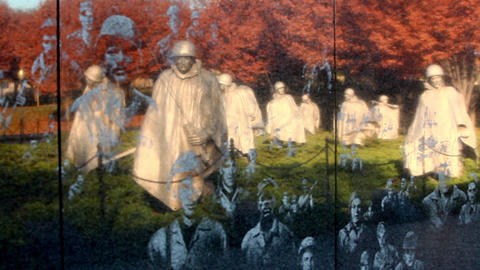 Panning shot of reflection of statues on the Korean War Veterans Memorial wall i Footage