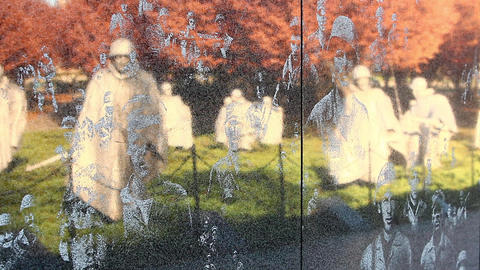 Close-up zoom of the Korean War Veterans Memorial wall in Washington DC Footage