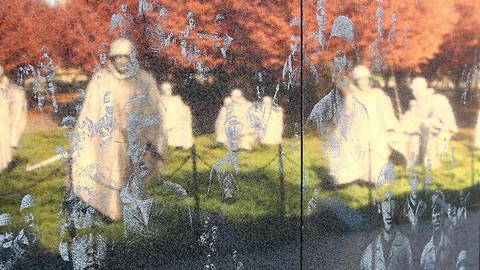 Close-up zoom of the Korean War Veterans Memorial wall in Washington DC Footage