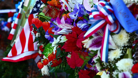 Close-up of flowers and flags with rack focus at the Korean War Veterans Memoria Footage