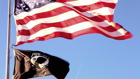 Upward tilting close-up shot of Korean War Veterans Memorial flags in Washington Footage