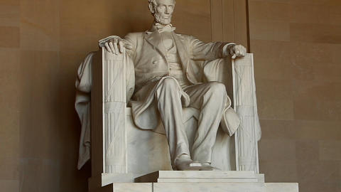 Tilt shot of the Abraham Lincoln statue inside the Lincoln Memorial in Washingto Footage