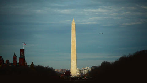 A static shot of the Washington Monument in Washington DC against a cloudy sky Footage
