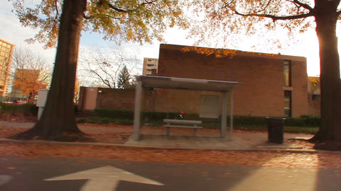 Tracking shot of a bus station bench in Washington DC in autumn Footage