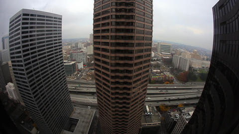 Super wide angle looking at other buildings from a high level floor Footage