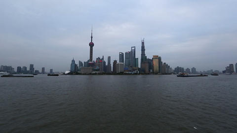 View overlooking the Huangpu River toward many towers in Shanghai, China Footage