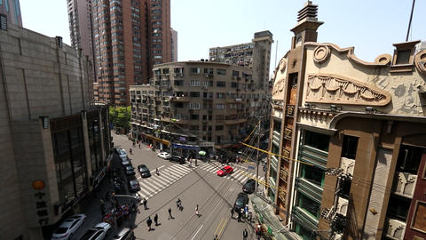 Static shot looking down on intersection in Shanghai, China Footage