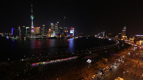 Wide view overlooking the Huangpu River toward many towers in Shanghai, China Footage