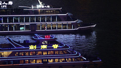Zoomed static view of 2 ships as they cruise through the frame on the Huangpu Ri Footage
