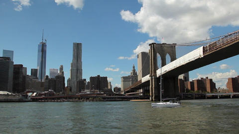 View of New York City while floating the East River at the Brooklyn Bridge Footage