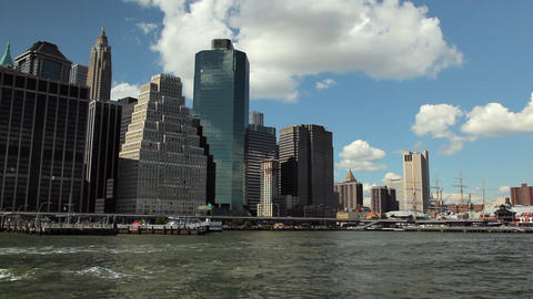 View of the New York City Skyline while floating the East River by ferry Footage