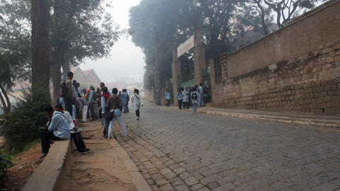 Foggy view of teeange kids hanging out on the street as they are going to schooo Footage