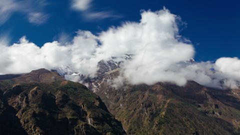 Time-lapse of clouds moving around Himalayan mountains Footage