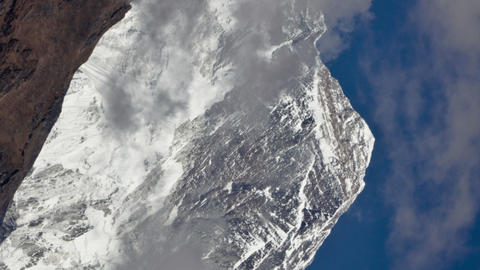 Vertical shot of Time-lapse of clouds swirling around Mount Everest Footage