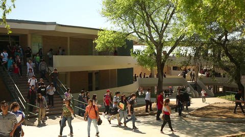 Kids walking around campus after class was let out at a University Footage