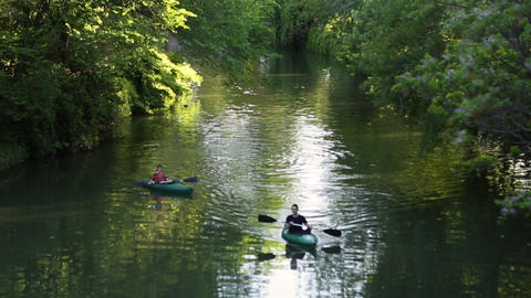 View of people paddling kayaks down the San Antonio River Footage