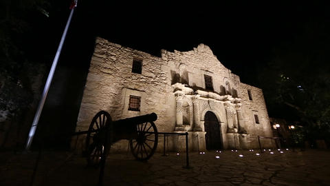 Slow downward panning view of the Alamo at night Footage