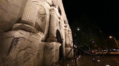 Upward panning view from the side of the Alamo at night Footage