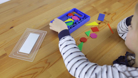 Preschooler exploring geometric shapes, shapes and colors Footage