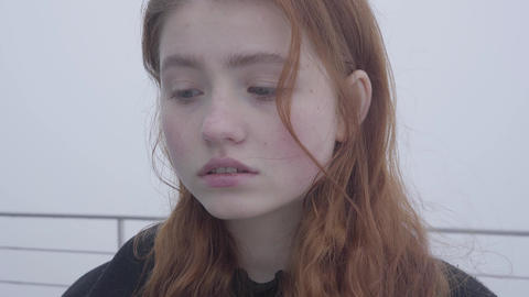 Close up portrait of young redhead pretty woman posing and smiling t in cold Footage