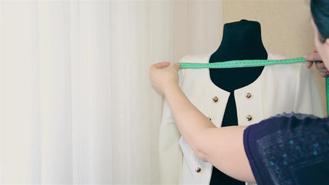 Woman designer women's clothing trying on clothes on a mannequin Live Action