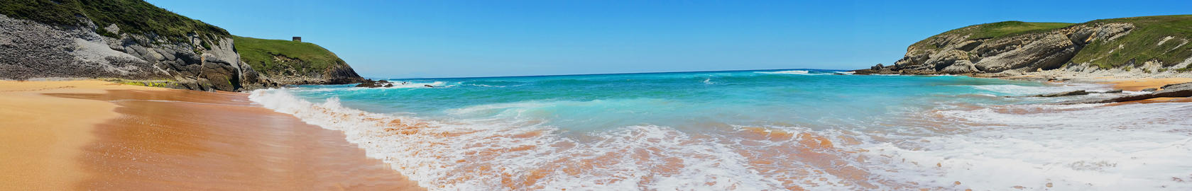 Beach with beautiful waves and blue sky, landscape. Panoramic photo フォト