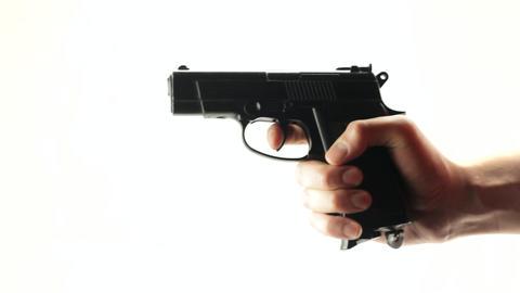 Man shoots a black gun on a white background Live Action