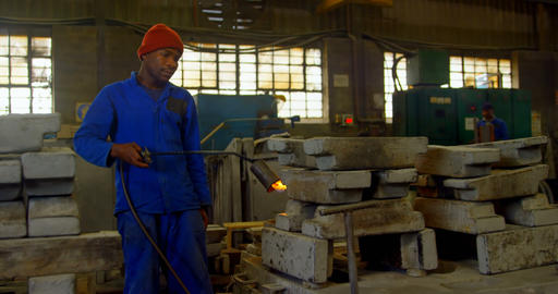 Worker heating metal mold with blow torch in foundry workshop 4k Live Action