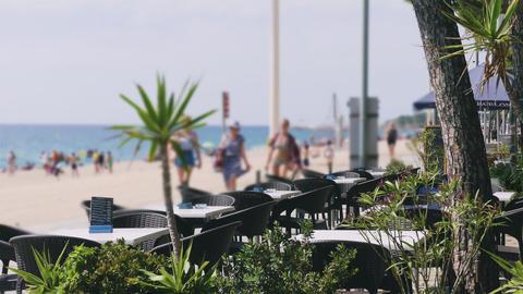 Empty Tables of Beachside Restaurant Next To Walkway GIF