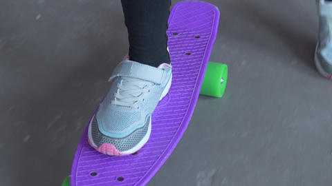 Teenager legs riding on skateboard. Young teenager skateboarding outdoors Footage