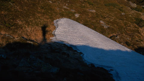 Shadow of a tourist walking and entertaining in the Carpathians in slo-mo Live Action