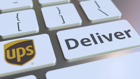 Keyboard with UPS company logo and Deliver text on the keys. Editorial Live Action