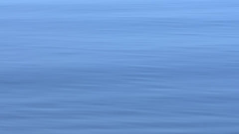 Close up of the calm blue water. Slow motion Archivo