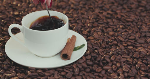 Cup of Coffee. Stirring with spoon. Close up of a beautiful coffee. Stirring Footage