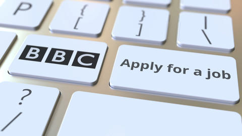 Computer keyboard with BBC logo and Apply for a job text on the keys. Editorial Footage