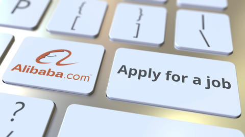 ALIBABA company logo and Apply for a job text on the keys of the computer Footage