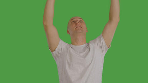 Adult caucasian man rise up virtual banner or panel by hands at keyed Footage