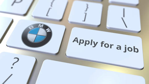 Computer keyboard with BMW logo and Apply for a job text on the keys. Editorial Footage