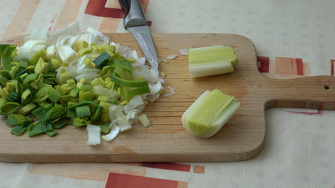 Natural fresh cutted leeks on the wooden cutting board.... Stock Video Footage