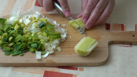 Natural fresh cutted leeks on the wooden cutting board. Closeup of sliced leek. Slices of the fresh Live Action