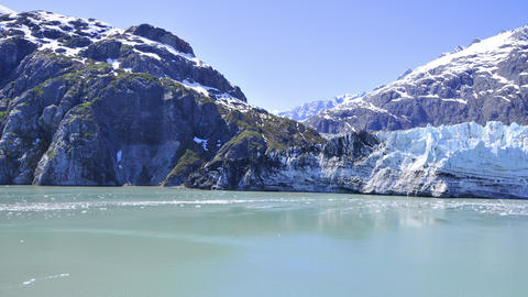 Shot of snow covered mountains and small ice glaciers floating in the water, Ala Footage
