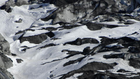 View of the side of a glacier and snow covered mountain in Glacier Bay, Alaska Footage
