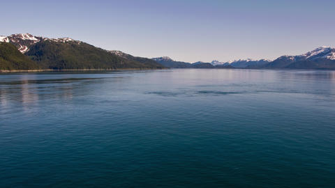 Traveling time-lapse of mountains around the ocean near Glacier Bay, Alaska Footage