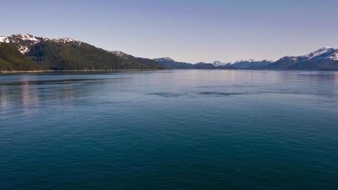 Traveling time-lapse of mountains around the ocean near Glacier Bay, Alaska Footage