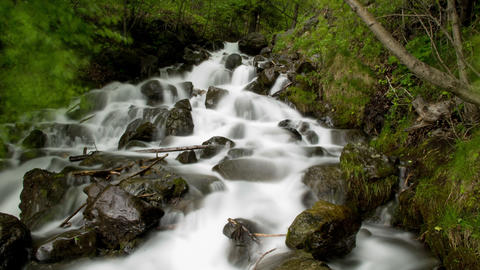 Low angle stationary time lapse view of a gorgeous rocky waterfall in Alaska Footage