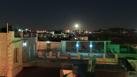 Time lapse of moonrise over Israeli rooftops Footage